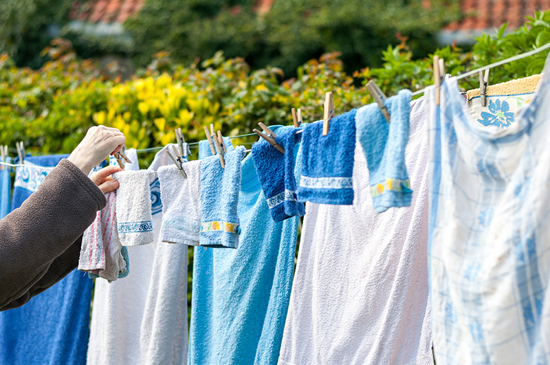 Hanging out the washing - Elderly Care Laundry services - Monarch Laundry